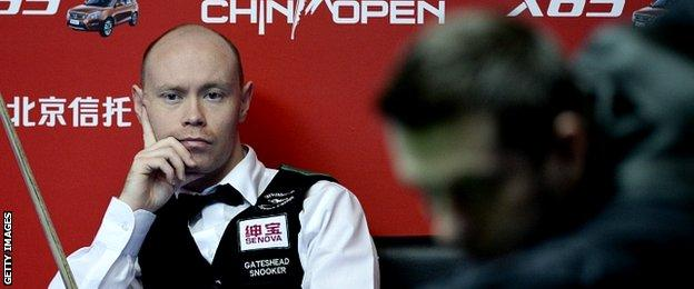 England's Gray Wilson (L) looks on as compatriot Mark Selby plays a shot during the final of the 2015 World Snooker China Open in Beijing