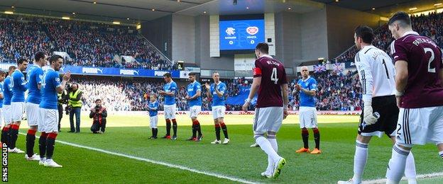 Champions Hearts were applauded on to the Ibrox pitch by the Rangers team