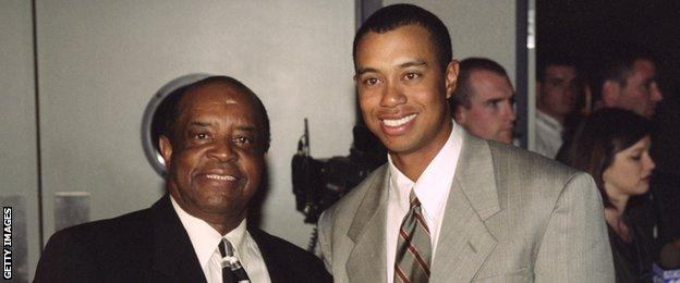 Lee Elder pictured with Tiger Woods in 2000