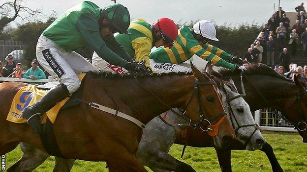 AP McCoy onboard Gilgamboa clears the last with Giitane Du Berlais ridden by Ruby Walsh and Smashing ridden by JJ Burke