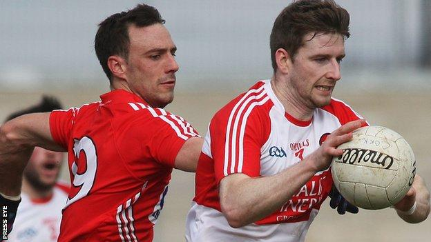 Paddy Kelly of Cork closes in on Derry's Niall Holly