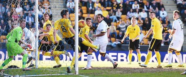Alloa striker Michael Chopra (centre) watches on as his effort hits the post