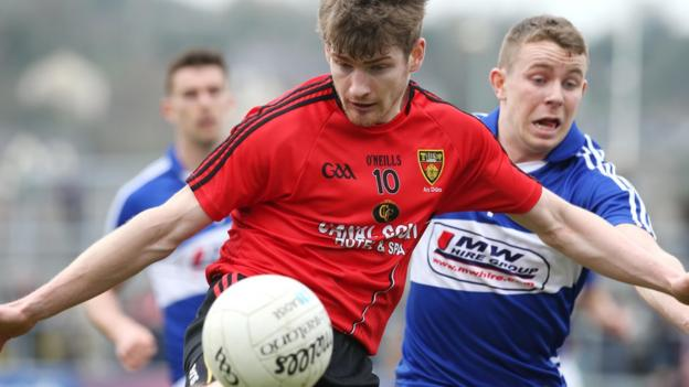 Conor Laverty in action against Damian Strong of Laois during the Division Two match which saw Down win 3-12 to 1-15 to clinch promotion