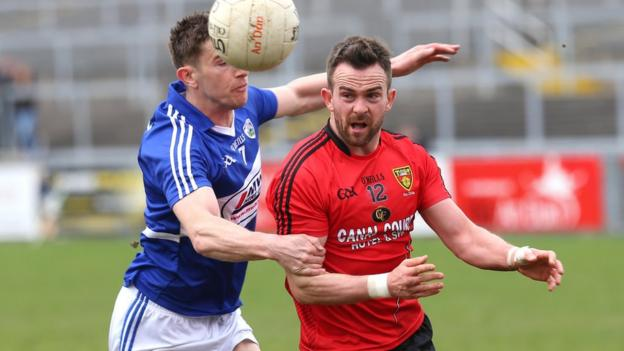 Down's Mark Poland in action against Colm Begley of Laois at Pairc Esler