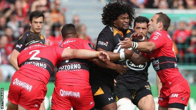 Wasps flanker Ashley Johnson takes on three Toulon defenders