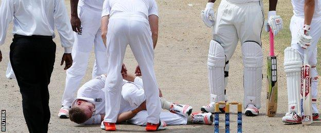 Stuart Broad clutches his ankle