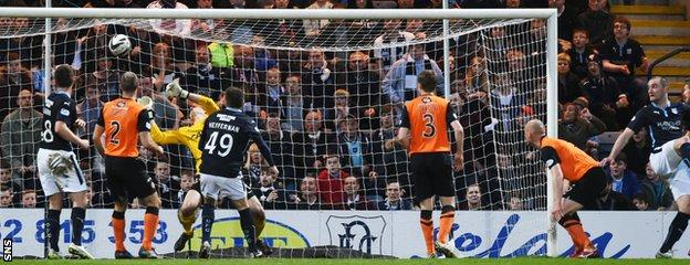 James McPake (right) heads Dundee into a 2-1 lead