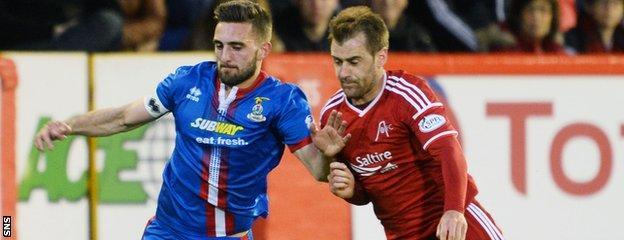Graeme Shinnie (left) will be an Aberdeen player next season