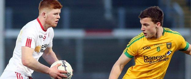 Tyrone's Cathal McShane takes on Donegal opponent Tony McClenaghan in the Celtic Park final