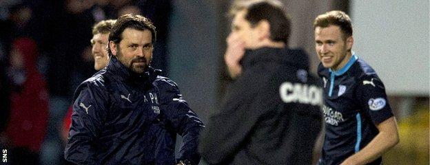 Dundee boss Paul Hartley (left) enjoys his first derby victory over Dundee United