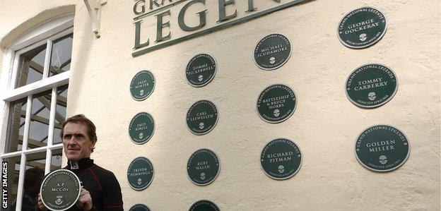 Tony McCoy with his plaque as a Grand National legend