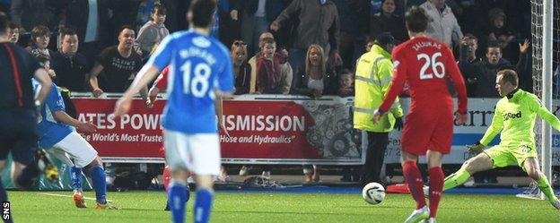 Gavin Reilly scores Queen of the South's third goal