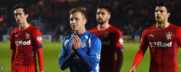 Queen of the South's Scott Hooper applauds the home fans