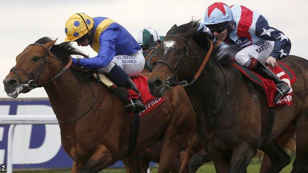 Outback Traveller ridden by Ryan Moore (left) in action at Kempton on Sunday