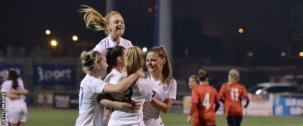 England women U19s celebrate Leah Williamson's successful penalty