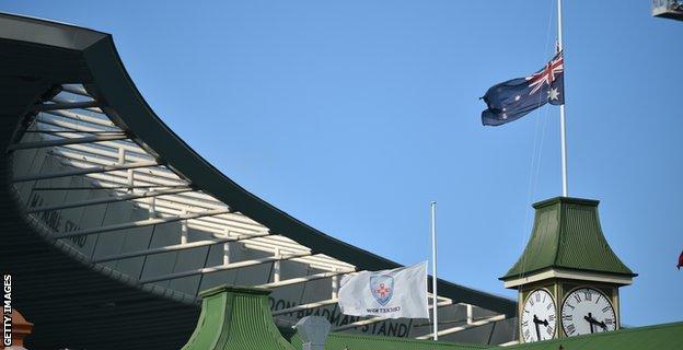 Australian flag flying at half mast