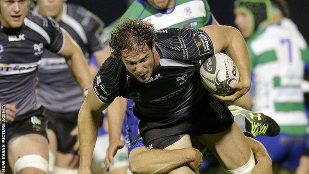 Tyler Ardron on the attack for Ospreys is tackled by Treviso's Edoardo Gori