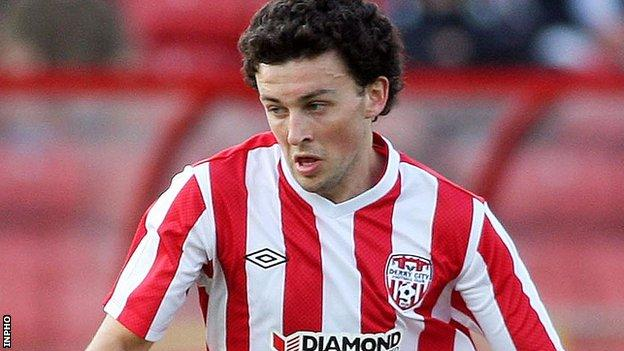 Derry's Barry McNamee was denied twice by last-ditch tackles