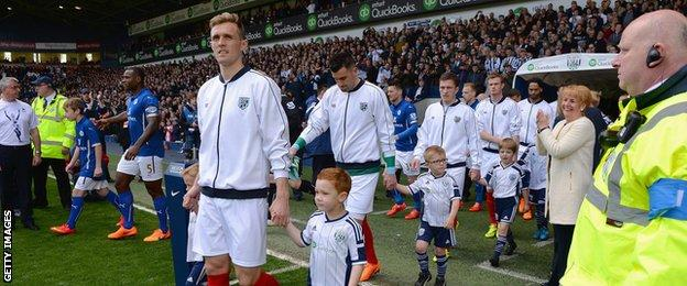 Darren Fletcher leads out West Brom against Leicester