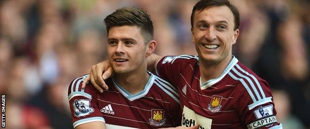 Aaron Cresswell and Mark Noble of West Ham