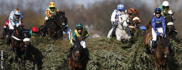Leighton Aspell leads the Grand National aboard Many Clouds