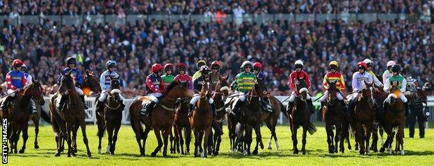 Riders await the start of the Grand National