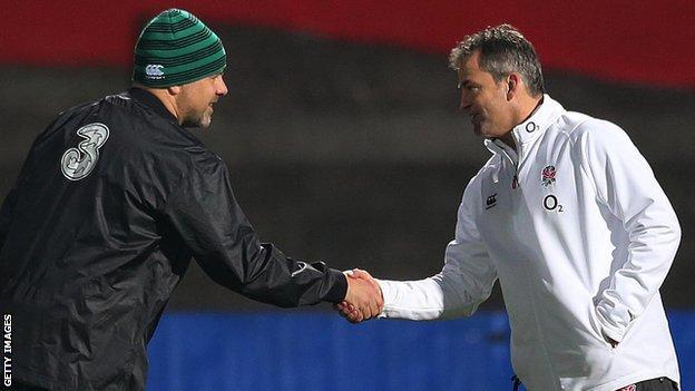 Ireland Wolfhounds coach Dan McFarland shakes hands with Saxons coach Jon Callard