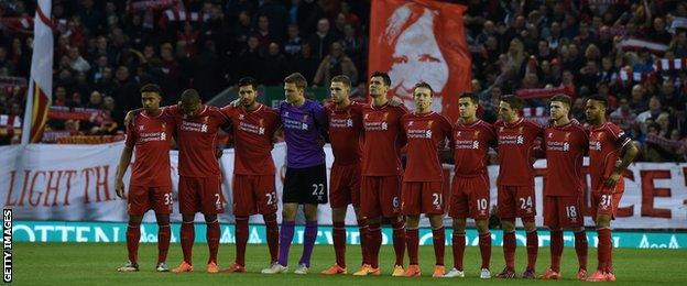 Liverpool players observe a minute's silence
