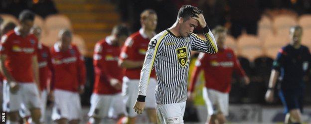 St Mirren midfielder Stevie Mallan shows his disappointment