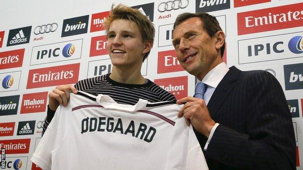 Martin Odegaard with Real Madrid institutional relations director Emilio Butragueno