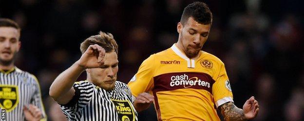 St Mirren's Marc McAusland challenges Motherwell's Marvin Johnson