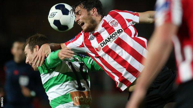 Patrick Gregg of Shamrock Rovers is beaten to the high ball by Derry's Philip Lowry
