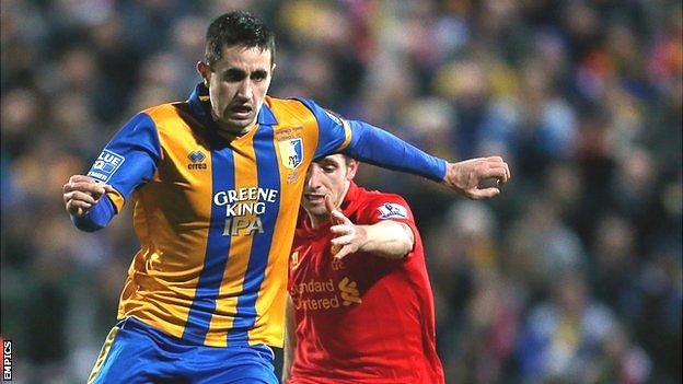 Chris Clements in action for Mansfield against Liverpool in the FA Cup in 2013