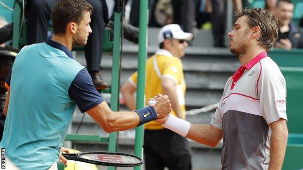 Grigor Dimitrov (left) greets Stan Wawrinka after his victory
