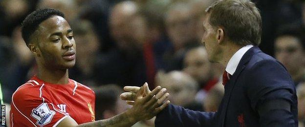 Liverpool forward Raheem Sterling with manager Brendan Rodgers