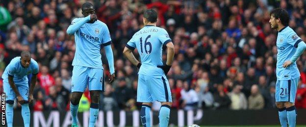 Yaya Toure and Manchester City team-mates