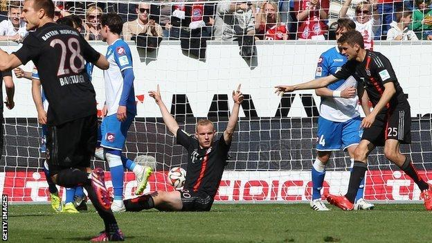 Bayern Munich's Sebastian Rode celebrates his goal against Hoffenheim