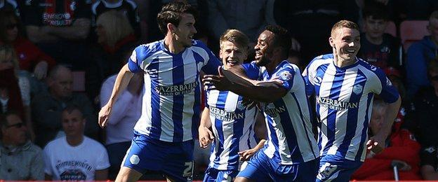 Kieran Lee celebrates with Sheffield Wednesday team mates