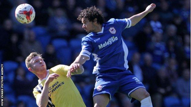 Fabio of Cardiff City challenges Aiden O'Brien of Millwall