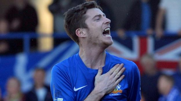 Glenavon's Andy McGrory celebrates after scoring the penalty which secured a 3-2 win over Portadown and qualification for next season's Europa League