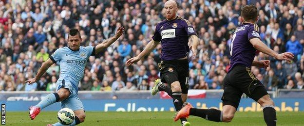 Manchester City striker Sergio Aguero (left) scores his side's second goal in the win over West Ham