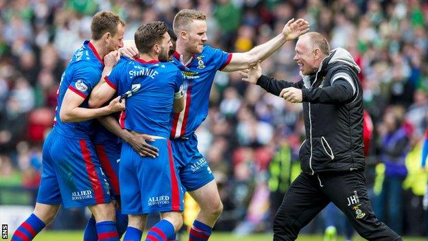 John Hughes congratulates his Inverness players after Edward Ofere scored against Celtic in the Scottish Cup semi-final on Sunday