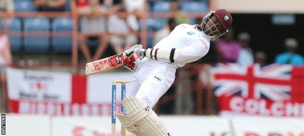 Marlon Samuels sways out of the way of an England bouncer