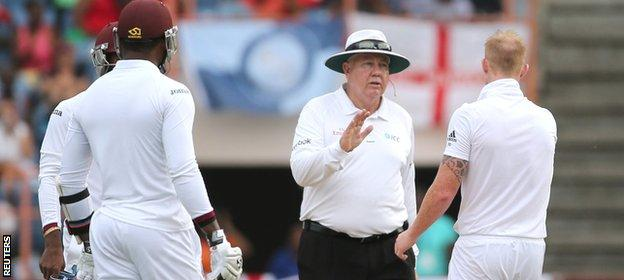 Umpire Steve Davis has a word with Stokes after the bowler takes his sledging a little too far