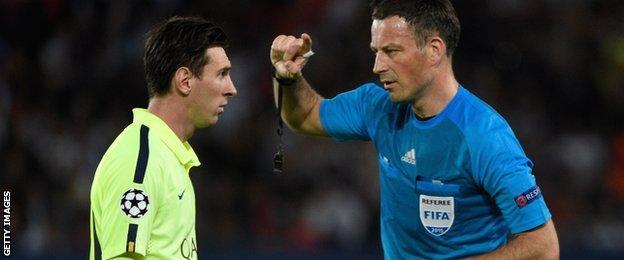 Lionel Messi and Mark Clattenburg