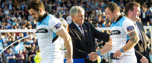 Glasgow Warriors duo Alex Dunbar and Ryan Grant collect their runners-up medals after the 2013/14 Pro12 final