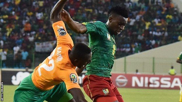 Benjamin Moukandjo (right) in action against Ivory Coast at the Nations Cup