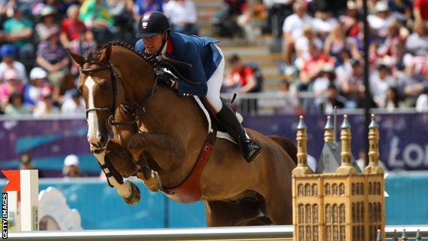 The French equestrian team compete at the 2012 Olympics