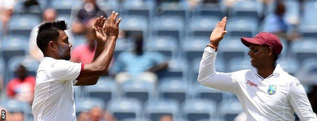 Devendra Bishoo (left) celebrates a wicket with Shiv Chanderpaul