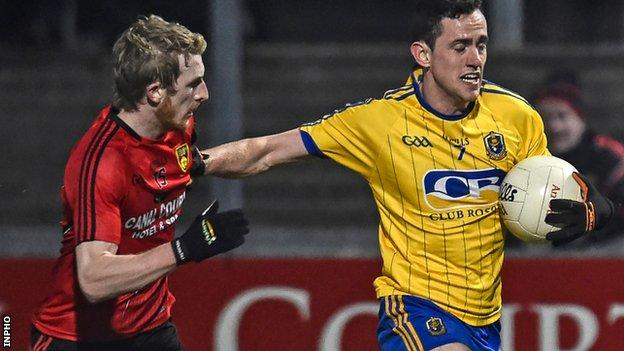 Down's Danny Savage is held off by Roscommon opponent Ciaran Cafferty